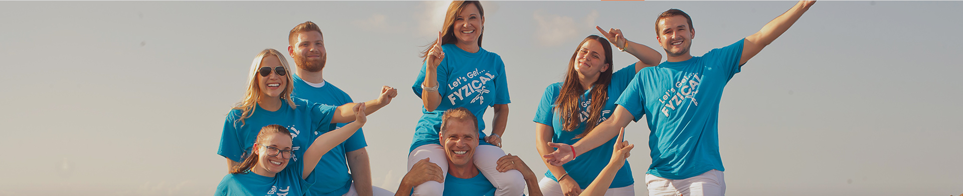 physical therapists takes group photo at the beach