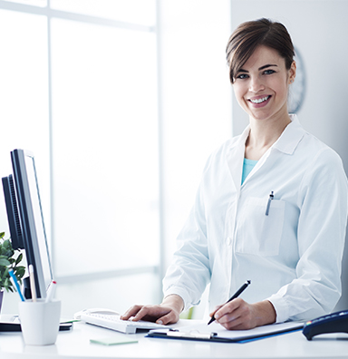 physician writing a referral for patients