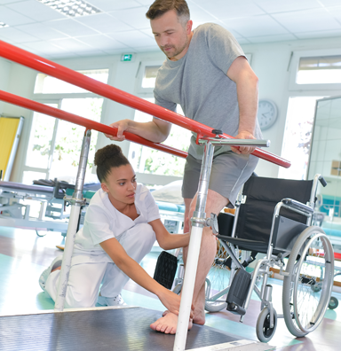 Patient learning to walk again using rails for balance