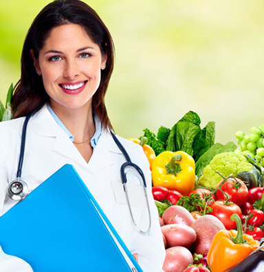 Nutritionist standing next to a bowl of vegetables