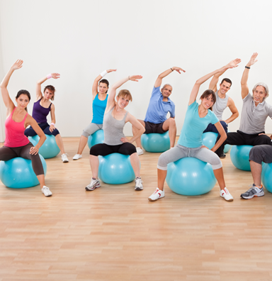 small group stretching in a Pilates studio