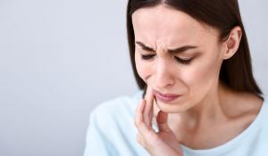 How does the Temporomandibular Joint (TMJ) cause headaches?
