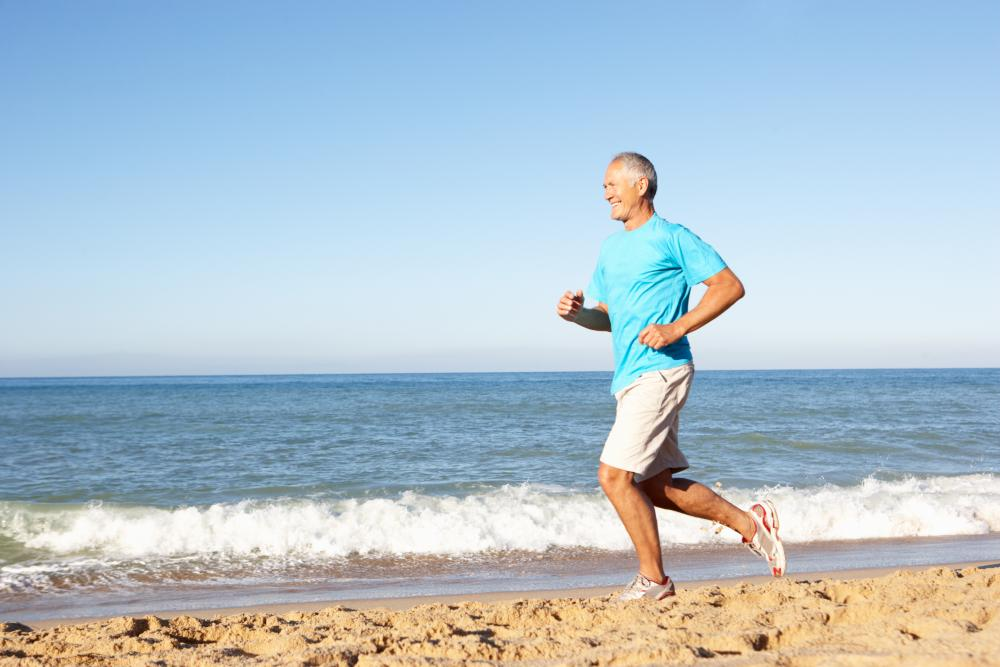 Elderly man running on the beach